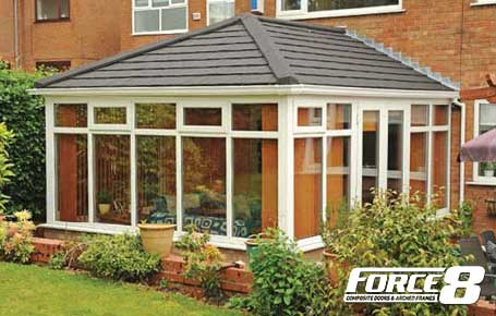 Grey Solid Roof on White PVCU conservatory