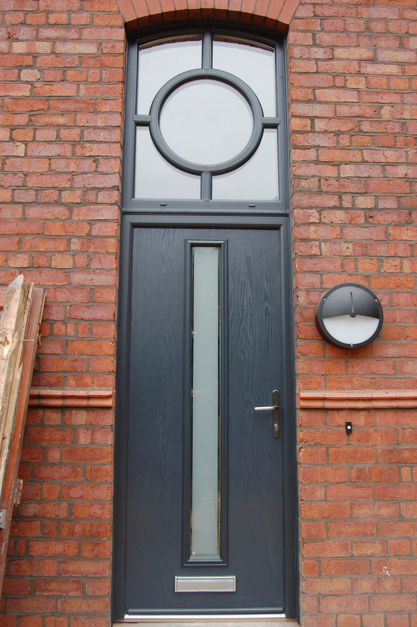 genoa door in anthracite grey and wood grain finish with satin glass