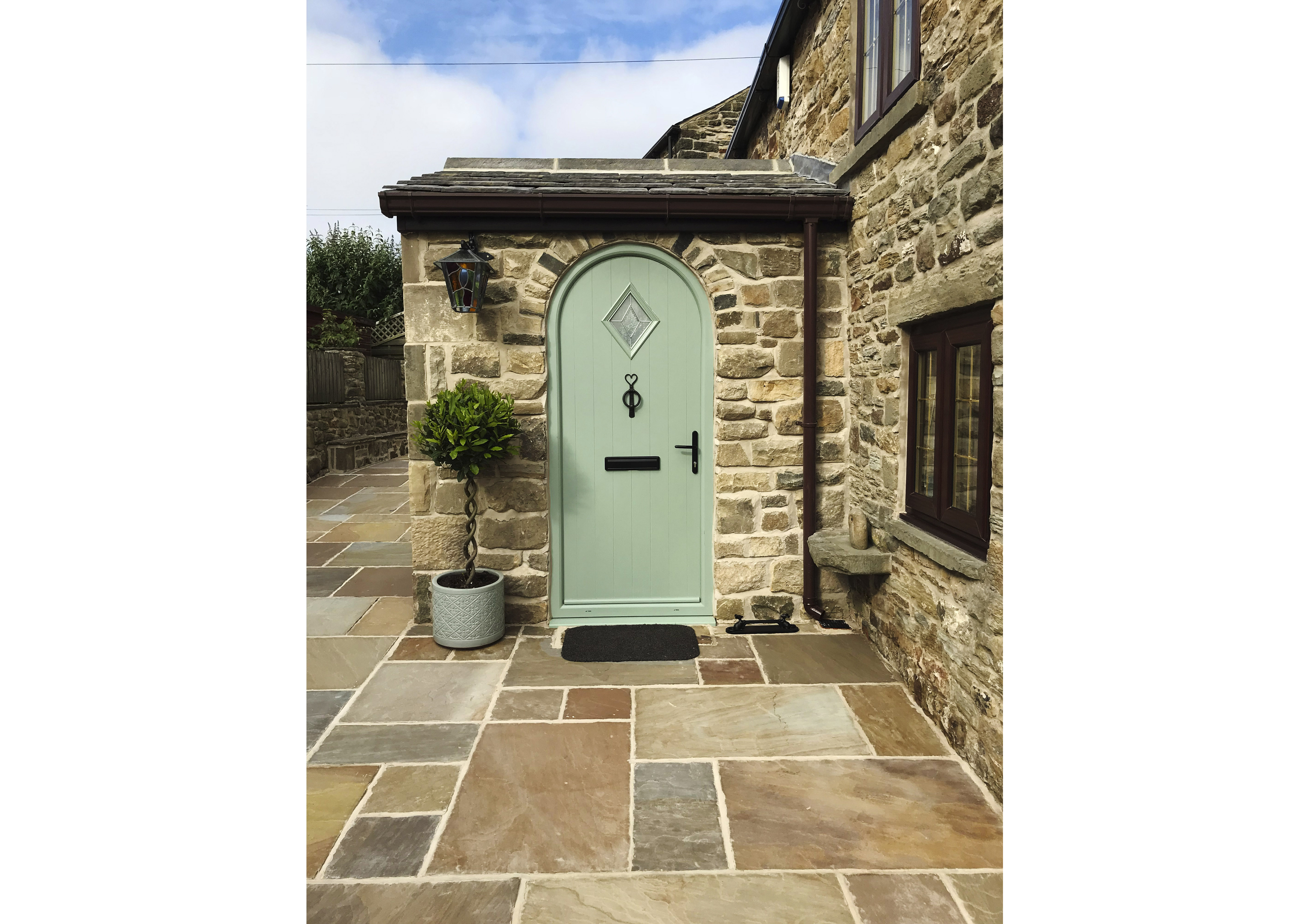 Happy customer with an arched composite door