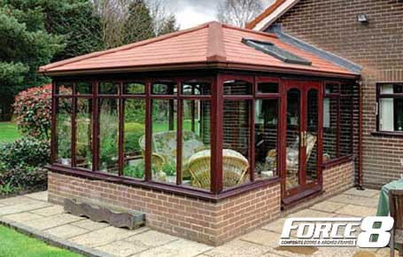 Red Solid Roof with Velux Window on red PVCU conservatory