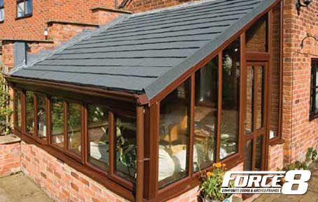Slanted grey Sold Roof on Rosewood Conservatory